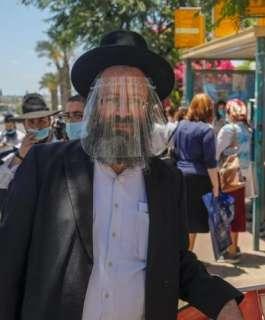 الاحتلال : العودة للكمامات وتأجيل دخول السياح
